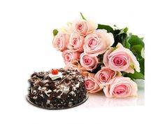 Combo Gifts Cute 12 Pink Roses Hand Bunch With Half Kg Delicious Chocolate Cake to Your Near and Dear Ones http://www.hyderabadflowergifts.com/combo-gifts/combo-gifts-4