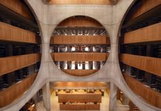 The building's dramatic centerpiece is a spectacularly beautiful central atrium, which features huge circle-cut concrete frames revealing the library's book stacks.
