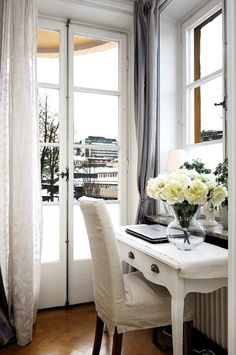 Pretty work desk and fresh flowers