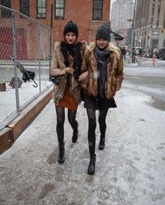 fabulous winter fur coats, skirts w/ tights and tall socks, knitted hats and scarfs #winter fashion #winter layers #street-style