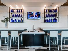 These boutique loft apartments' eclectic mix of materials creates a look that is at once rustic and elegant. #loft #apartment #amenities #chicago #blue #bottles #lounge