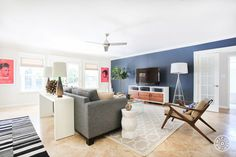 A dark blue accent wall helps this living area stand out.