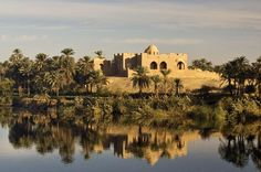 Mosque, River Nile From the Nile, Egyptian life and historical buildings can be observed, such as this secluded mosque near Luxor.