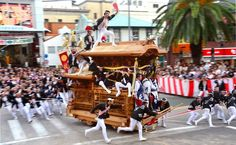 "A lot of muscle power goes into pulling this ""danjiri"" wooden float through the streets at the Kishiwada Danjiri Festival on Sept. 15.  Osaka Prefecture"