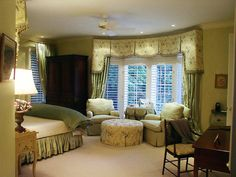 I love this room....the colors, window treatments, bay windows and chairs and ottoman. LOVE IT!