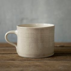 """With a generous size that's equally suited for cozy cocoa or a warming soup, this mug is our favorite winter companion. Each mug is shaped and glazed by hand in a South African design collective, guided by an ethos of environmental and cultural awareness.- Glazed stoneware ceramic- Dishwasher and microwave safe- Handmade in South Africa3.25""""H, 4.5"""" diameter"""