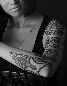 Gecko & Polynesian Motifs tattooed on the Arm of a Beautiful girl