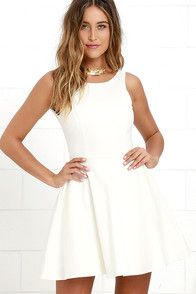 The little white dress is every stylish girl's must-have, and the Play On Curves Ivory Backless Dress is one you'll cherish forever! Skinny straps support a high rounded neckline as they crisscross and tie over an alluring open back with scalloped trim. The lightweight, woven bodice has princess seams that travel to a fitted waist, above the flaring skirt (with more scalloped detail!). Hidden back zipper with clasp.