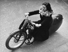 A woman test driving a motorcycle on the streets of Milan, 1951.
