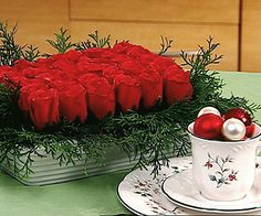Rectangle of Roses so beautiful as a  centerpiece and so simple yet so dramatic. Fill in a block of floral foam with deep red roses to grace your holiday table.