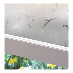 A bathroom window that has it all, including privacy film with pretty etched scrolls.