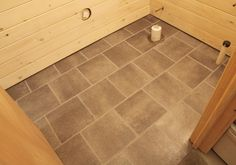 vinyl stick on tile - faux slate tile even with grout!  Looks pretty good... home depot coastal gray