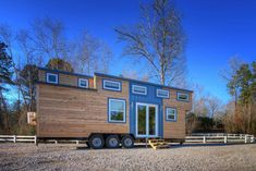 This beautiful tiny house is a modified version of Alabama Tiny Homes' most popular model, the Freedom. This version includes a murphy bed instead of a trundle, a tub in the bathroom, an even bigger closet than the original, and additional storage space in the raised floors.