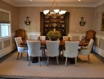 Traditional dining room with strie walls above the panels. We replaced the light fixture, but no new photo...