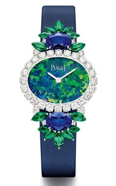 Piaget watch with emeralds, blue sapphires, diamonds and an opal High Jewelry, Luxury Jewelry, Bling Jewelry, Unique Jewelry, Amazing Watches, Beautiful Watches, Piaget Jewelry, Art Deco Watch, Stylish Watches