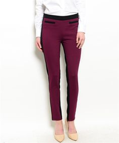 Our burgundy stretch woven pants feature a mixed colored trim, with a black waist, pocket and backside. In addition an ankle length hem for a hot stylish look. Country: Imported Fabric Content: 67.5%