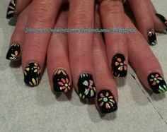 Colorful flower spring nails :D $20 acrylic nail special from now until Mother's Day.  Follow me on my nail page at www.facebook.com/nailsbyjami #colorfulnails #funnails #cutenails #nailprodigy #nailpro #naildesigns #handpaintednails #art #nailpolish #nailsmagazine #peoriail #peoriailnailtech #uniquenails #nailart #naildesigns #springnailart #flowernailart #flowers #multicolorednailart #blacknails #acrylicnails #squarenails #nailpro #nailartgallery #nailartjunkie