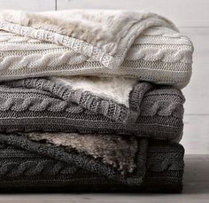 charcoal gray, tan, and cream cable knit blankets with soft fur on the back - i love these cozy double sided blankets for winter!