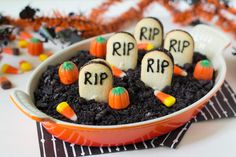 Try this delicious chocolate cheesecake dip thats underneath this spooky Halloween graveyard