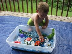 Play Create Explore: Ocean Sensory Bin  Sensory Bins ARE A NECESSITY. No ifs, ands or buts about it. You MUST HAVE them for all infants and toddlers. They must be supervised, but it's amazing to watch them with them.