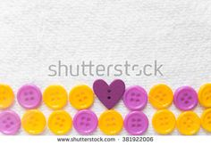 Beautiful bright round plastic buttons on a light background, buttons for sewing colored, bright plastic buttons on the background cloth.Sewing buttons, Plastic buttons, Buttons close up