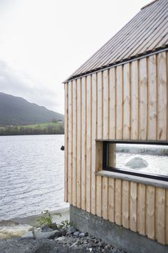 Naust V is a collaboration between Kolab Architects and Koreo Architects. The project is a transformation of an old boat house in Vikebygd, a small village o. Coastal Entryway, Coastal Farmhouse, Coastal Homes, Coastal Cottage, House Cladding, Timber Cladding, Wood Facade, Living Room Furniture Layout, Coastal Furniture