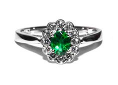 #200-10424 - LADIES 14 KARAT WHITE GOLD OVAL CUT ('A' QUALITY .30 CARAT) EMERALD RING WITH 12 ROUND CUT (VS-SI ~ D QUALITY) DIAMONDS TOTALING .17 CARATS. PLEASE CONTACT STADLER'S FOR MORE INFORMATION