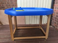 Home-made wooden tuff spot tray stand