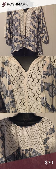 Free People Boho Lace Peasant Shirt Blue rose print. Sheet lace inset. Drawstring neckline. Cinched stretch cuffs on 3/4 sleeves. It is a size XS but can also fit as a small. In good pre loved condition. Free People Tops Blouses