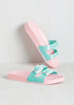 Prancing past wave pools and spiral slides in these slip-on jellies is enough to make anyone ecstatic! Bubblegum pink, molded footbeds support dotted turquoise straps with white buckles - delightful details that give these sandals a style so joyful, some may say they were made to have fun in!