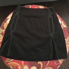 Sport Haley black skort Brand: sport Haley : Size 2 : condition:10/10 : this is a skort so there is shorts inside of skirt . Sport haley Shorts Skorts