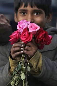 In Pakistan, a boy sells roses for Valentine's Day