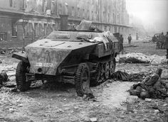 "Destroyed armored vehicle Sd.Kfz.250 from the 11th SS Division ""Nordland"" on Friedrichstrasse in Berlin."