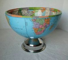 Half the World, Upcycled Globe Bowl I used a broken globe, some pages from a 1970 map book and part of a discarded cake stand and TAH DAH! we have a cool bowl! a one of a kind conversation piece. Globe Crafts, Map Crafts, Old Globe, Globe Art, Vintage Globe, Vintage Maps, Feng Shui, Architecture Design, Diy Projects