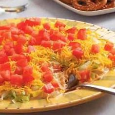 Took this Taco Dip to a retirement party and everybody loved it and wanted the recipe. I doubled the first 4 ingredients, and placed in a larger oblong glass serving dish. Also added sliced black olives on top. Served with Corn Chips. Delicious. Will make again and again!!