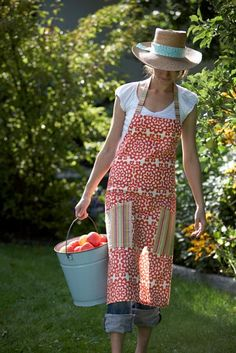 .bucket full of apples & a lovely apron too!