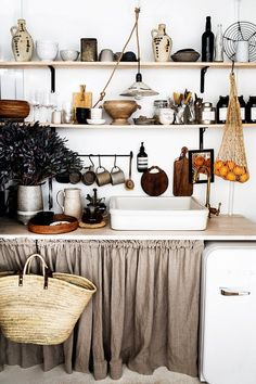 Above: Open shelf kitchen: This inviting kitchen by Kara Rosenlund mixes gorgeous ceramic and vintage pieces that are in a similar colour palette that works so beautifully. Pax Regal, Leather Daybed, Kara Rosenlund, Saarinen Table, Sweet Home, Small Space Kitchen, Open Shelf Kitchen, Small Spaces, Home Living