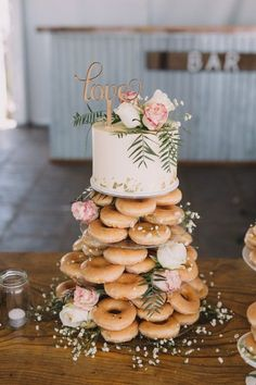 Farm at our feet, ocean on the horizon' Couple's coastal rustic wedding Real Weddings is part of Wedding donuts - This coastal rustic wedding was all about the venue an amazing privately owned farm offering both country and coastal views Donut Wedding Cake, Wedding Donuts, Krispy Kreme Wedding Cake, Wedding Cake Lace, Krispy Kreme Donut Cake, Rustic Wedding Cupcakes, Wedding Cake Simple, Wedding Cake Guide, Rustic Birthday Cake