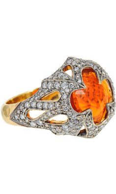 Cathy Waterman Fire Opal Ring  $11,510  Notes: Like the way setting displays the stone. Brilliant color