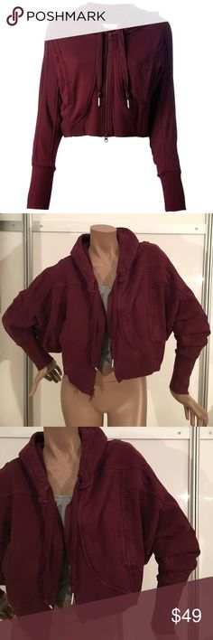 Stella McCartney x Adidas Cropped Burgundy Hoodie Pre-owned. No rips or smells but it has been worn and washed. It's still in amazing condition and has tons of life left. It just has a little bit of color fading and minor pilling. Adidas by Stella McCartney Sweaters