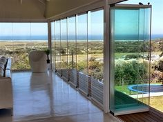 Frameless glass stacking doors ... Put these in at Plett ~ they are amazing
