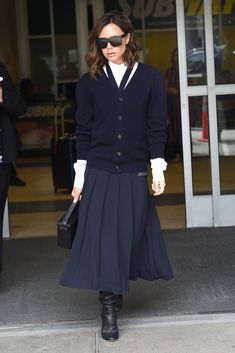 Victoria Beckham Puts a Posh Spin on Her Signature Pleated Skirt