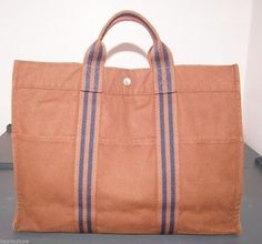 Hermes Canvas Dark Red Blue H Logo Tout Tote Bag. Get one of the hottest styles of the season! The Hermes Canvas Dark Red Blue H Logo Tout Tote Bag is a top 10 member favorite on Tradesy. Save on yours before they're sold out!