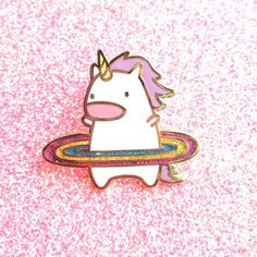 The unicorn is working on its hot body, and decided a rainbow makes a great hula hoop! This is a hard enamel pin and has a gold finish, so shiny! The rainbow also has glitter added for that extra magic. This pin might just encourage you to reach for that higher goal! The pin measures about 1 inch tall and 1 inch wide and comes packaged with a black rubber pin back.