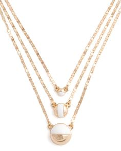 Sometimes less is more. The Blanc Trois Necklace is a minimalistic, yet chic approach to one of our favorite trends, layering. About the Necklace: Shiny gold finish with white enamel accent. Total length is 15.5-20 with a 2 extender chain and lobster claw closure. Neck Drop is 7.5-8.5. ONLY@JM