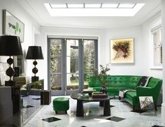 The family room features a French mirrored cabinet and a pair of Maison Jansen lamps, all from the a Italian sofa, and a artwork by Piero Fornasetti that has been turned into a light box; the throw is by Hermès. Living Room Green, My Living Room, Small Living, Living Room Decor, Modern Living, Cozy Living, Dining Room, Dining Table, White Rooms
