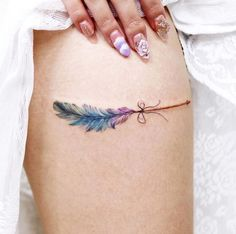 With all the beautiful tattoo designs floating around social media youd be hard-pressed to find a woman who hasnt at l. Unique Tattoos For Men, Trendy Tattoos, Small Tattoos, Girl Tattoos, Tattoos For Guys, Feather Arrow Tattoo, Arrow Tattoos, Feather Tattoos, Tattos