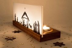 """Have yourself a merry little Christmas"" with this beautiful and modern nativity scene. Three candle lights shining through the acrylic glass create a serene a Merry Little Christmas, Family Christmas, Christmas Time, Diy Nativity, Christmas Nativity Scene, Christmas Projects, Holiday Crafts, Holiday Decor, Christmas Ideas"