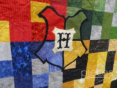I must have this. Some day, some way. Harry Potter Inspired Hogwarts House Quilt  by PiecesByPollyQuilts