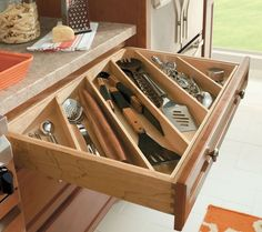 Drawer sections easilyseparate larger and smaller kitchen tools. -What an awesome idea! I am adding this to the list for the kitchen when I get to the cabinets. Lol...